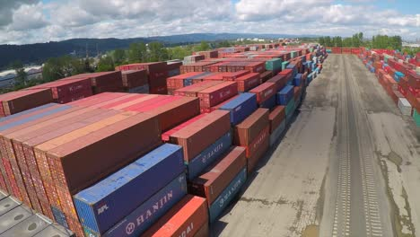 An-aerial-over-a-rail-freight-yard-with-containers-in-transit-2