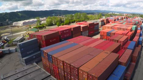 An-aerial-over-a-rail-freight-yard-with-containers-in-transit-3