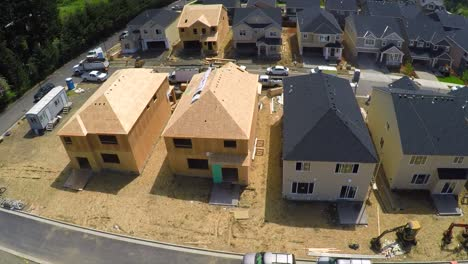 An-aerial-image-over-houses-under-construction-in-a-subdivision