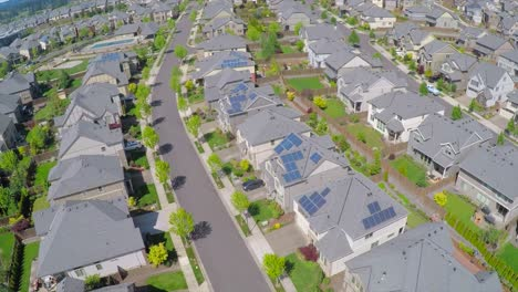 An-aerial-image-over-a-vast-subdivision-of-housing-units-in-a-neighborhood