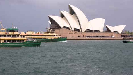 Ferry-boats-pass-in-Sydney-harbor-with-Opera-House-background