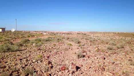 Aerial-drone-shot-reveals-the-outback-bush-opal-mining-town-of-Coober-Pedy-Australia