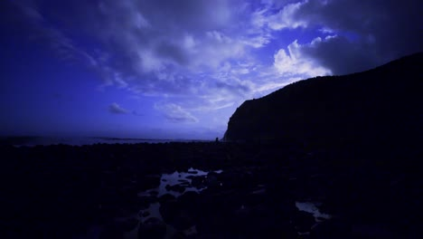 Beautiful-time-lapse-shot-of-clouds-moving-behind-a-moonlit-peninsula