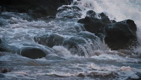 Blue-waves-roll-into-the-coast-of-Hawaii-in-slow-motion-and-break-over-rocks-1