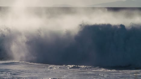 Blue-waves-roll-into-the-coast-of-Hawaii-in-slow-motion-during-a-big-storm