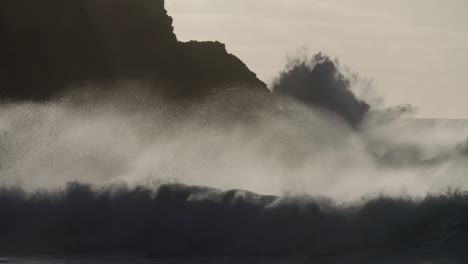 Blue-waves-roll-into-the-coast-of-Hawaii-and-crash-into-the-shore-in-slow-motion-during-a-big-storm-1