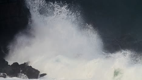 Waves-crash-against-a-rocky-shore-in-extreme-slow-motion