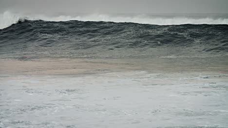 Large-green-waves-roll-into-the-coast-of-Hawaii-in-slow-motion-1