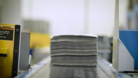 Newspapers-are-stacked-and-processed-in-a-newspaper-factory-1