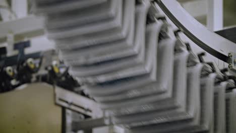 Newspapers-move-along-an-overhead-conveyor-belt-at-a-newspaper-factory