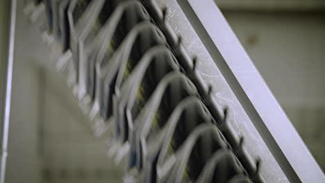 Newspapers-move-along-an-overhead-conveyor-belt-at-a-newspaper-factory-1