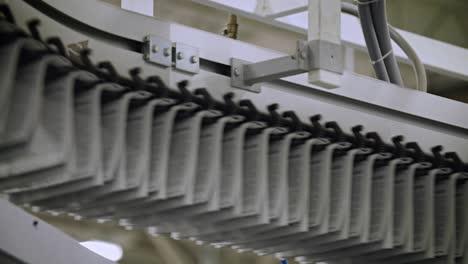 Newspapers-move-along-an-overhead-conveyor-belt-at-a-newspaper-factory-3