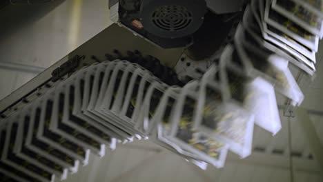 Newspapers-move-along-an-overhead-conveyor-belt-at-a-newspaper-factory-5