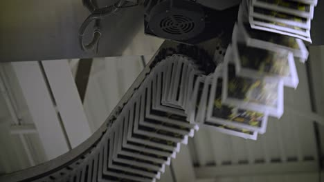 Newspapers-move-along-an-overhead-conveyor-belt-at-a-newspaper-factory-7