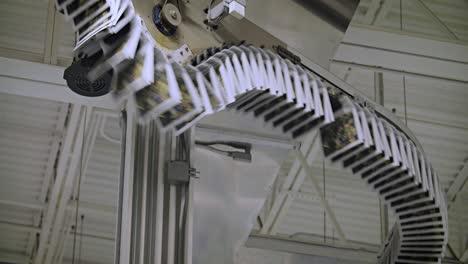 Newspapers-move-along-an-overhead-conveyor-belt-at-a-newspaper-factory-8