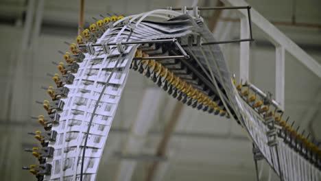 Newspapers-move-along-an-overhead-conveyor-belt-at-a-newspaper-factory-12