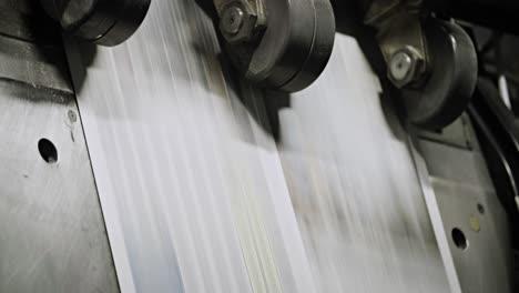Newspapers-move-along-an-overhead-conveyor-belt-at-a-newspaper-factory-13