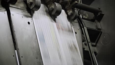 Newspapers-move-along-an-overhead-conveyor-belt-at-a-newspaper-factory-15