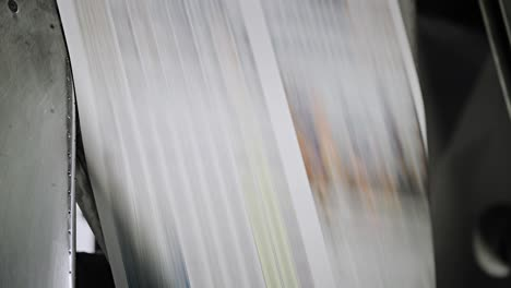Newspapers-move-along-an-overhead-conveyor-belt-at-a-newspaper-factory-16