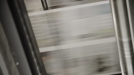 Newspapers-move-along-a-conveyor-belt-at-a-newspaper-factory-1