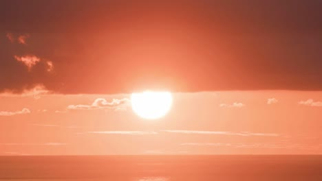 The-sun-sets-in-a-huge-orange-ball-in-time-lapse