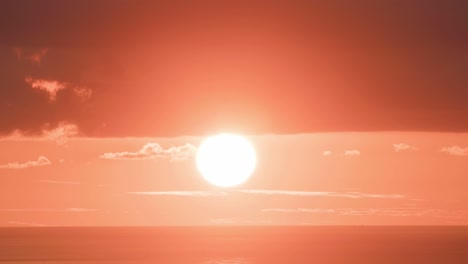 The-sun-sets-in-a-huge-orange-ball-in-time-lapse-1