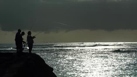 Fishermen-cast-at-sunset-at-Ala-Moana-Beach-Park-in-Honolulu-Hawaii