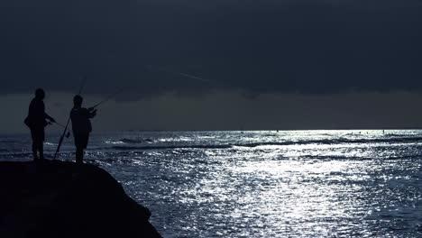 Fishermen-cast-at-a-cool-blue-sunset-at-Ala-Moana-Beach-Park-in-Honolulu-Hawaii
