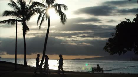 Scenic-with-walkers-and-jogger-at-Ala-Moana-Beach-Park-in-Honolulu-Hawaii