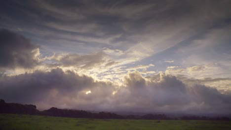 Time-lapse-of-clouds-moving-over-green-fields-on-the-island-of-Molokai-Hawaii