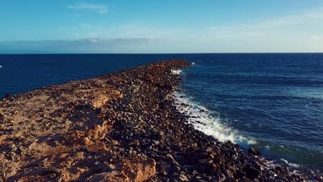 Nice-aerial-shot-over-rocky-Molokai-Hawaii-beach-and-coastline