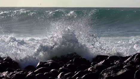 Blue-waves-roll-into-the-coast-of-Hawaii-and-break-on-the-shore-8