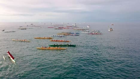 Beautiful-aerial-over-many-outrigger-canoes-at-the-start-of-a-race-in-Hawaii-1