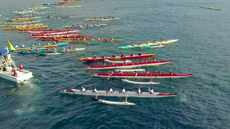 Beautiful-aerial-over-many-outrigger-canoes-at-the-start-of-a-race-in-Hawaii-2