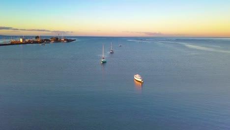 Aerial-over-boats-moored-offshore-at-Kaunakakai-Wharf-Molokai-Hawaii-