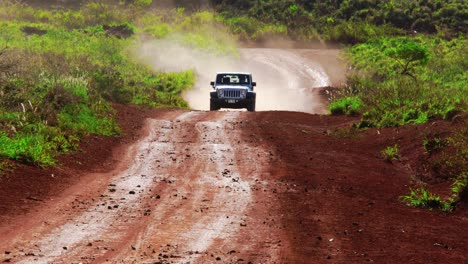 A-silver-Jeep-drives-along-a-red-dirt-road-on-the-island-of-Lanai-in-Hawaii-7