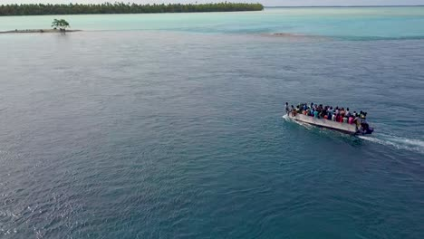 A-ferry-of-refugees-or-residents-travels-across-the-Tabuaeran-Lagoon-on-the-Pacific-Island-of-Kiribati