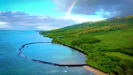 Aerial-over-Kahina-Pohaku-fish-pond-along-coast-of-Maui-Hawaii-with-rainbow