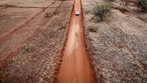 Aerial-over-a-pickup-truck-driving-on-a-dirt-road-on-Molokai-Hawaii-from-Maunaloa-to-Hale-o-Lono