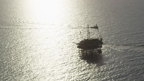 A-beautiful-aerial-shot-over-a-boat-heading-out-to-oil-derricks-and-platforms-in-the-Santa-Barbara-Channel-California-1