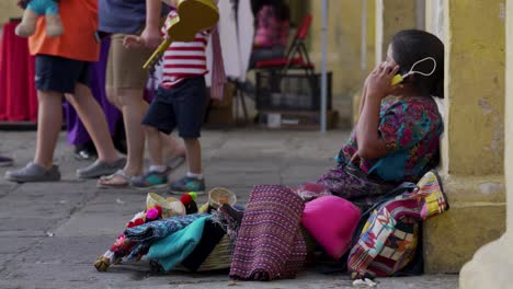 A-Guatemalan-woman-speaks-on-a-cell-phone-on-a-busy-street