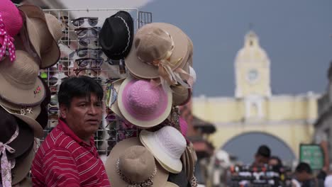 A-man-sells-hats-on-a-busy-street-in-Antigua-Guatemala