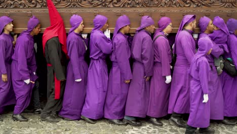Purple-robed-priests-carry-coffins-in-a-colorful-Christian-Easter-celebration-in-Antigua-Guatemala