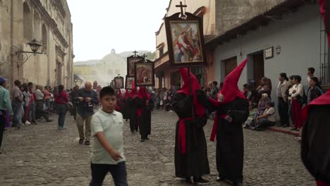 Purple-robed-priests-carry-religious-placards-in-a-colorful-Christian-Easter-celebration-in-Antigua-Guatemala