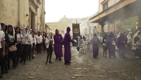Robed-priests-carry-incense-burners-in-a-colorful-Christian-Easter-celebration-in-Antigua-Guatemala