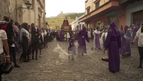 Robed-priests-carry-incense-burners-in-a-colorful-Christian-Easter-celebration-in-Antigua-Guatemala-1