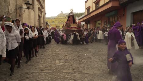 Robed-priests-carry-incense-burners-in-a-colorful-Christian-Easter-celebration-in-Antigua-Guatemala-2
