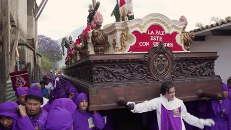 Purple-robed-priests-carry-giant-coffins-in-a-colorful-Christian-Easter-celebration-in-Antigua-Guatemala