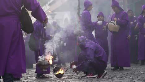 Purple-robed-priests-carry-incense-burners-in-a-colorful-Christian-Easter-celebration-in-Antigua-Guatemala-1