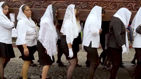 Women-carry-giant-coffins-in-a-colorful-Christian-Easter-celebration-in-Antigua-Guatemala